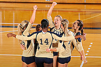 11 September 2011:  FIU's team (pictured, Jovana Bjelica (16), Renele Forde (14), Marija Prsa (10), Una Trkulja (7), Andrea Lakovic (1)) celebrate winning the first set as the FIU Golden Panthers defeated the Florida A&M University Rattlers, 3-0 (25-10, 25-23, 26-24), at U.S Century Bank Arena in Miami, Florida.