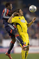 New England Revolution midfielder Sainey Nyassi (31) and Columbus Crew defender Gino Padula (4) battle for head ball. The Columbus Crew defeated the New England Revolution, 1-0, at Gillette Stadium on October 10, 2009.