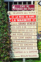 Road signs indicating the direction to various wine producers in Chateauneuf-du-Pape: Verger des Papes, Maison des Vins, La Mule du Pape, La Marmite, Grand Veneur, Clefs d'Or, Cabrieres les Siles, Pierre Usseglio, Clos Saint Andre, Boiron Maurice, des Senechaux, Mont Redon, de la Gardine, Moulin Tacussel  Chateauneuf-du-Pape Châteauneuf, Vaucluse, Provence, France, Europe  Chateauneuf-du-Pape Châteauneuf, Vaucluse, Provence, France, Europe