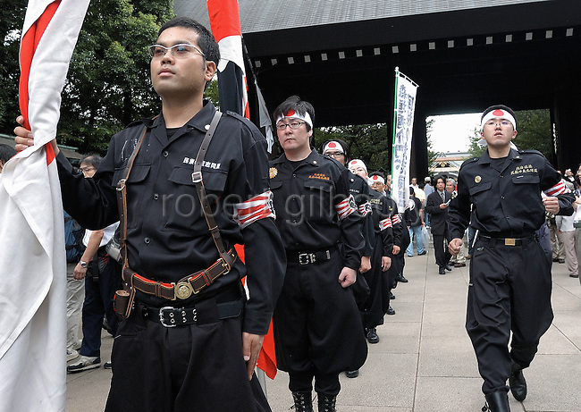 Japanese nationalists congregate at Yasukuni Shrine in Tokyo, Japan. very year on August 15, the day Japan officially surrendered in WWII, tens of thousands of Japanese visit the controversial shrine to pay their respects to the 2.46 million war dead enshrined there, the majority of which are soldiers and others killed in WWII and including 14 Class A convicted war criminals, such as Japan's war-time prime minister Hideki Tojo. Each year speculation escalates as to whether the country's political leaders will visit the shrine, the last to do so being Junichiro Koizumi in 2005. Nationalism in Japan is reportedly on the rise, while sentiment against the nation by countries that suffered from Japan's wartime brutality, such as China, has been further aggravated by Japan's insistence on glossing over its wartime atrocities in school text books...Photographer:Robert Gilhooly..y