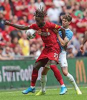Divock Origi of Liverpool and John Stones of Manchester City during the FA Community Shield match between Liverpool and Manchester City at Wembley Stadium on August 4th 2019 in London, England. (Photo by John Rainford/phcimages.com)<br /> Foto PHC/Insidefoto <br /> ITALY ONLY