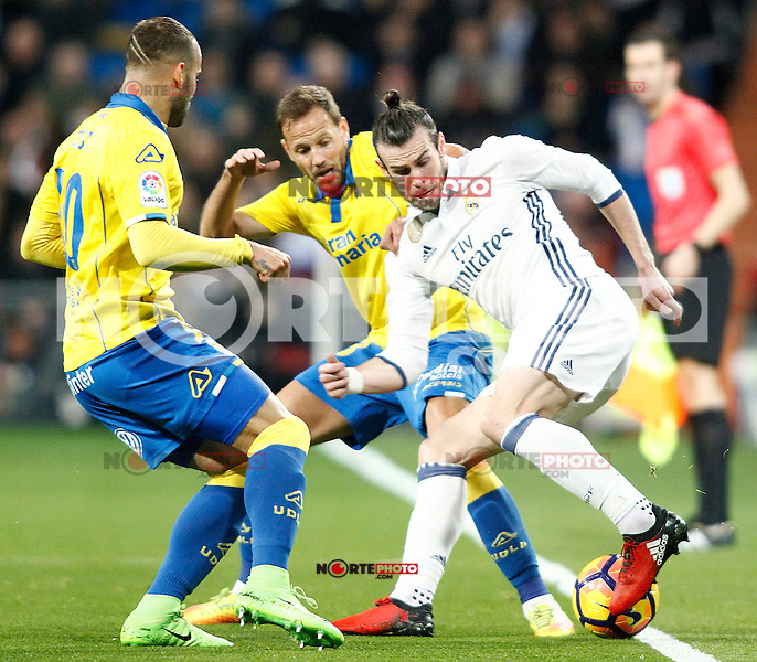 Real Madrid's Gareth Bale (r) and UD Las Palmas' Jese Rodriguez (l) and Dani Castellano during La Liga match. March 1,2017. (ALTERPHOTOS/Acero) /NortePhoto.com