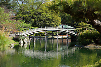 Engetsukyo Bridge at Ritsurin - a landscape garden in Takamatsu built by the local feudal lord during the Edo Period and considered one of the most esquisite gardens in Japan,  Ritsurin features ponds, hills and pavilions set in the woods which acts as background and a textbook example of borrowed scenery.
