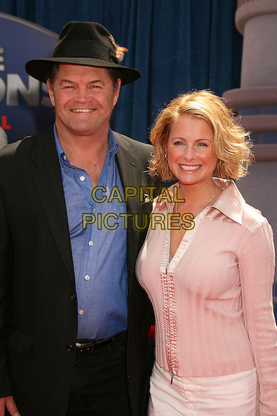 "MICKY DOLENZ & DONNA QUINTER .""Meet The Robinsons"" Los Angeles Premiere at the El Capitan Theatre, Hollywood, California, USA..March 25th, 2007.half length black suit jacket hat pink blouse husband wife married.CAP/ADM/BP.©Byron Purvis/AdMedia/Capital Pictures"