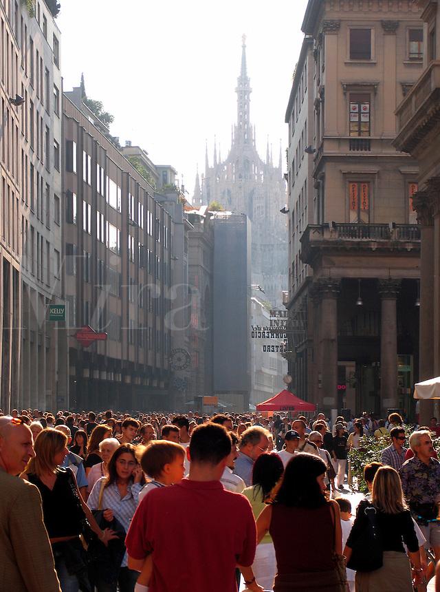 The Duomo and Saturday shopping crowd of people, Corso Vittorio Emanuele, Piazza San Babila, Milan, Ital