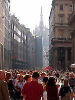 The Duomo and Saturday shopping crowd of people, Corso Vittorio Emanuele, Piazza San Babila, Milan, Ital
