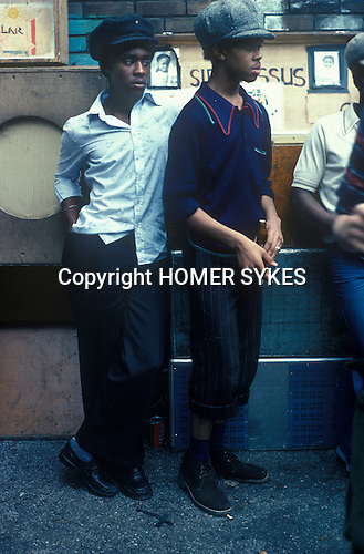 Notting Hill Carnival 1976 London. Black teens listening to music.<br />