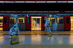 """Pictured: Kızılay subway station in Ankara, Turkey. <br /> <br /> Pictured: Municipal workers kitted out in PPE disinfect the futuristic and dystopian scenes of subway stations and the idyllic celestial-like interiors of a number of mosques as the city of Ankara prepares for life post-coronavirus in Turkey.<br /> <br /> Photographer Dilek Uyar photographed the mesmerising scenes as workers from the Health Affairs unit of Ankara Municipality traverse across the city of Ankara disinfecting spaces in which large numbers of people gather. <br /> <br /> This includes the busy subway station of Kızılay, where passengers are required to wear facial masks when travelling on public transport. Workers are shrouded in a cloud of mist as they work amongst the post-apocalyptic scenes of the metro station. <br /> <br /> Workers can also be pictured amongst the deserted Ankara Kocatepe and the Ahmet Hamdi Akseki  mosques in Ankara, working beneath the enormous planet-like chandeliers in the foyer of the grand buildings.<br /> <br /> Ms Uyar said """"Since the number of patients has gradually decreased, the mosques in the city have opened to worship within the framework of social distancing and hygiene rules. Municipal teams are disinfecting mosques constantly to ensure the public spaces are safe for people"""".<br /> <br /> """"The workers spray all public transportation in Ankara, Turkey, day and night. They clean both inside and out of the subways and everywhere in the subway station."""" <br /> <br /> Please byline: Dilek Uyar/Solent News<br /> <br /> © Dilek Uyar/Solent News & Photo Agency<br /> UK +44 (0) 2380 458800"""
