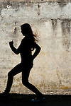 Portait of girl running in front of a cement wall at Fort Casey State Park Whidbey Island Washington State