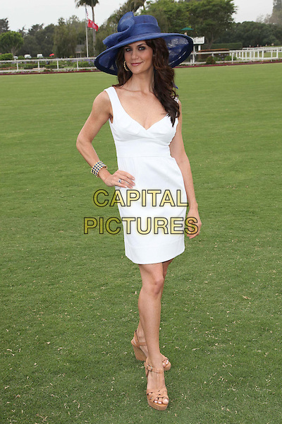 Samantha Harris.Audi At The Foundation Polo Challenge held at the Santa Barbara Polo & Racquet Club, Santa Barbara, California, USA, 9th July 2011..full length white dress blue navy hat hand on hip .CAP/ADM/KB.©Kevan Brooks/AdMedia/Capital Pictures.