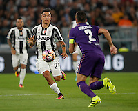 Calcio, Serie A: Juventus vs Fiorentina. Torino, Juventus Stadium, 20 agosto 2016.<br /> Juventus' Paulo Dybala, left, is challenged by Fiorentina's Gonzalo Rodriguez during the Italian Serie A football match between Juventus and Fiorentina at Turin's Juventus Stadium, 20 August 2016. Juventus won 2-1.<br /> UPDATE IMAGES PRESS/Isabella Bonotto