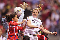 Rachel Buehler, right, of the United States and Raquel Rodriguez of Costa Rica go up for the ball in front of the goal during play in the CONCACAF Olympic Qualifying semifinal match at BC Place in Vancouver, B.C., Canada Friday Jan. 27, 2012. The United States won the match 3-0 to earn a berth in 2012 London Olympics.