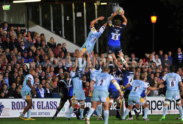 Dominic Day rises high to win lineout ball. Aviva Premiership match, between Bath Rugby and Northampton Saints on September 14, 2012 at the Recreation Ground in Bath, England. Photo by: Patrick Khachfe / Onside Images