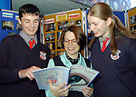 Studnets Mark Townley, Dawsons Domain and Michelle Skelly, Collon with their English teacher Clara Neavyn at the launch of Ardee Community School's magazine to mark the school's 25th anniversary..Picture Paul Mohan Newsfile