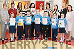 "Staff with some pupils of Dromtrasna NS whose work appears in their new book "" Past and Present"". Pictured are in front pupils l-r: Katie O'Connor, Brian Lyons, Sean Lyons, Emily McAuliffe, Leon Curtin, Liam Collins and Aoife Horgan. Back are staff l-r: Norma Healy, Tim Harnett, Claire Galvin, Norma O'Callaghan, Anne-Marie Downes, Aileen O'Connor, Margo Harnett, Marian McNamara, Margaret Sheehan and Eda O'Connor."