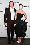 Yan Assoun and Polina Proshkina arrive at the annual Whitney Art Party hosted by the Whitney Contemporaries, and sponsored by Max Mara, at Skylight at Moynihan Station on May 1, 2013.