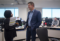NWA Democrat-Gazette/CHARLIE KAIJO Karthicka Krishnan, director of apparel jewelry and accessories, talks to John Furner, CEO of Sam's Club, on Friday, December 8, 2017 at the Sam's Club Home Office in Bentonville .