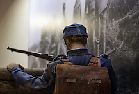 Soldier dressed in his Blue uniform with a rucksack made of Cow skin, holding his riffle. Mannequin dressed as a Soldier at an European Museum.