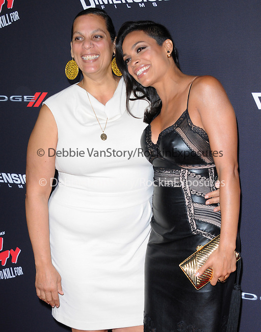 Rosario Dawson and her mom attends The Dimension Film's L.A. Premiere of FRANK MILLER'S SIN CITY: A DAME TO KILL FOR held at  The TCL Chinese Theatre in Hollywood, California on August  19,2014                                                                               © 2014 Hollywood Press Agency