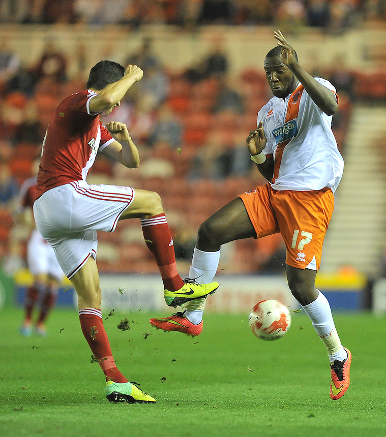 Blackpool's Ishmael Miller and Middlesbrough's Daniel Ayala battle for the ball<br /> <br /> Photographer Dave Howarth/CameraSport<br /> <br /> Football - The Football League Sky Bet Championship - Middlesbrough v Blackpool - Tuesday 30th September 2014 - Riverside stadium - Middlesbrough<br /> <br /> &copy; CameraSport - 43 Linden Ave. Countesthorpe. Leicester. England. LE8 5PG - Tel: +44 (0) 116 277 4147 - admin@camerasport.com - www.camerasport.com