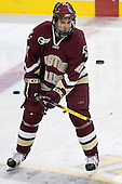Anthony Aiello juggles a puck during warmups - The Boston University Terriers defeated the Boston College Eagles 2-1 in overtime in the March 18, 2006 Hockey East Final at the TD Banknorth Garden in Boston, MA.