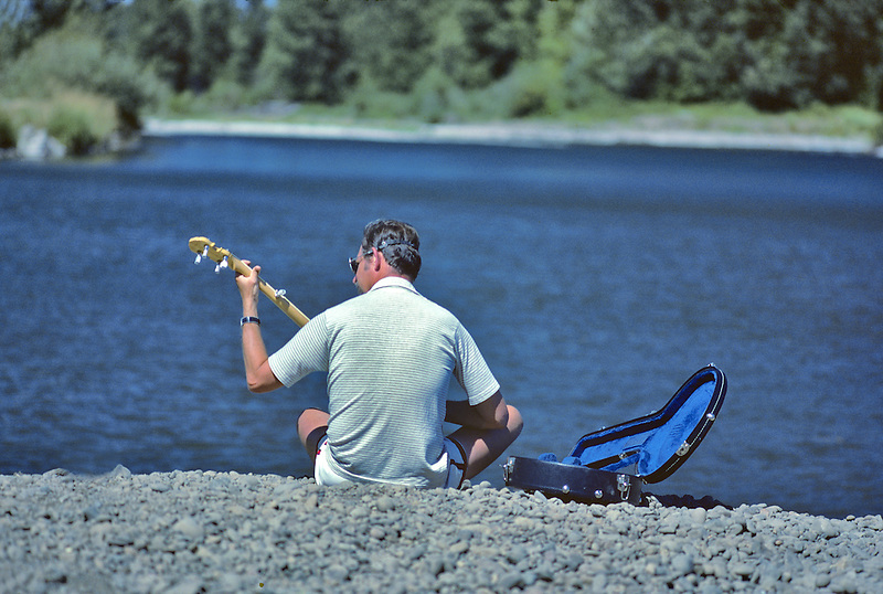 Banjo player on Willamette River. Oregon.