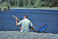 Banjo player on Willamette River. Oregon.