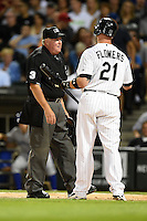 Umpire Time Welke listens to catcher Tyler Flowers (21) during a game between the Toronto Blue Jays and Chicago White Sox on August 15, 2014 at U.S. Cellular Field in Chicago, Illinois.  Chicago defeated Toronto 11-5.  (Mike Janes/Four Seam Images)