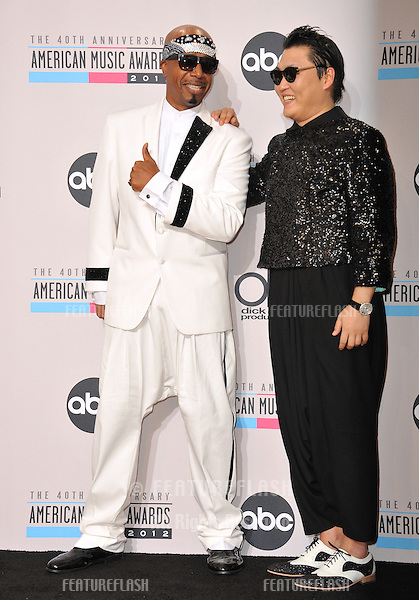MC Hammer & Psy (right) at the 40th Anniversary American Music Awards at the Nokia Theatre L.A. Live..November 18, 2012  Los Angeles, CA.Picture: Paul Smith / Featureflash