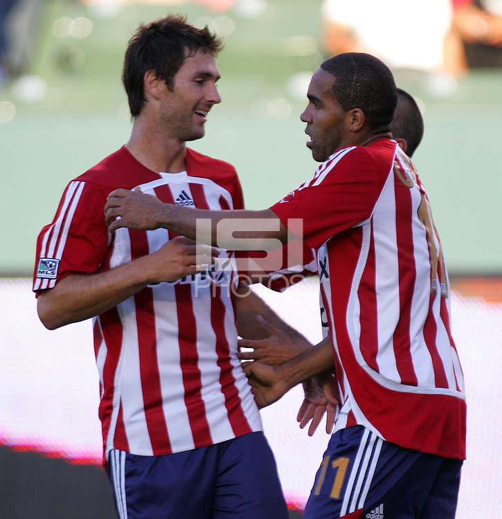 Chivas USA forward Maykel Galindo (11) celebrates his second goal with teammate forward Ante Rozov (9). CD Chivas USA defeated the New York Red Bulls 3-0 in an MLS regular season match at the Home Depot Center, Carson, CA, on September 9, 2007.