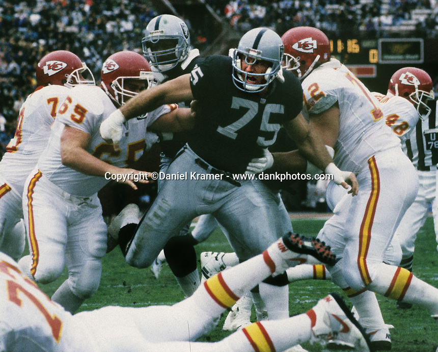 Howie Long puts pressure on the Kansas City Chiefs offense on December 6, 1992 as the Los Angeles Raiders defeated the Kansas City Chiefs at the Los Angeles Memorial Coliseum, 28-7.