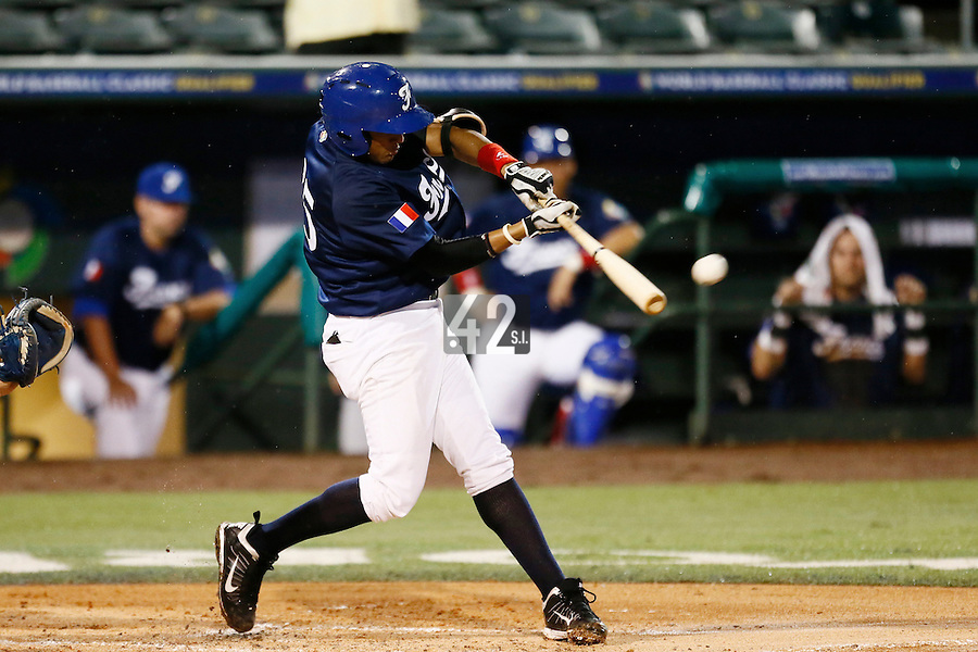 21 September 2012: Andy Paz hits the ball during France vs South Africa tie game 2-2, rain delayed at the end of the 9th inning at 1 AM, during the 2012 World Baseball Classic Qualifier round, in Jupiter, Florida, USA. Game to resume 22 September 2012 at noon.