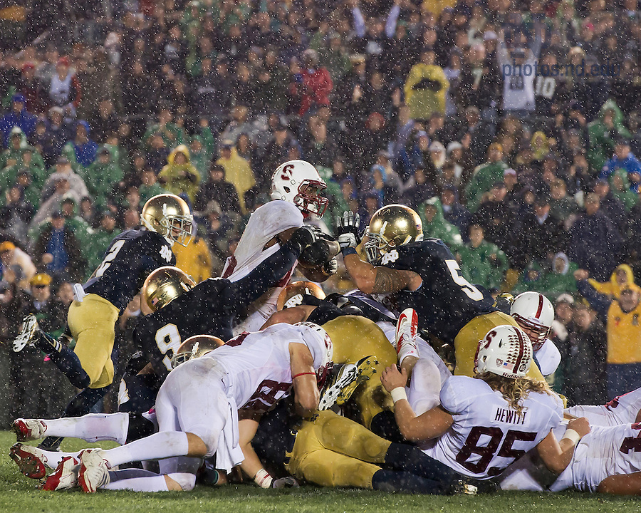 Stanford running back Stepfan Taylor (33) attempts to dive across the end zone as nose guard Louis Nix (9) and linebacker Manti Te'o (5) defend in the overtime period...Photo by Matt Cashore