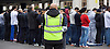 Far right activists protesting outside Regent's Park Mosque in Central London, Great Britain <br /> 3rd April 2015 <br /> <br /> <br /> Security standing guard over Muslims who are about to pray at the Mosque. <br /> <br /> Photograph by Elliott Franks <br /> Image licensed to Elliott Franks Photography Services