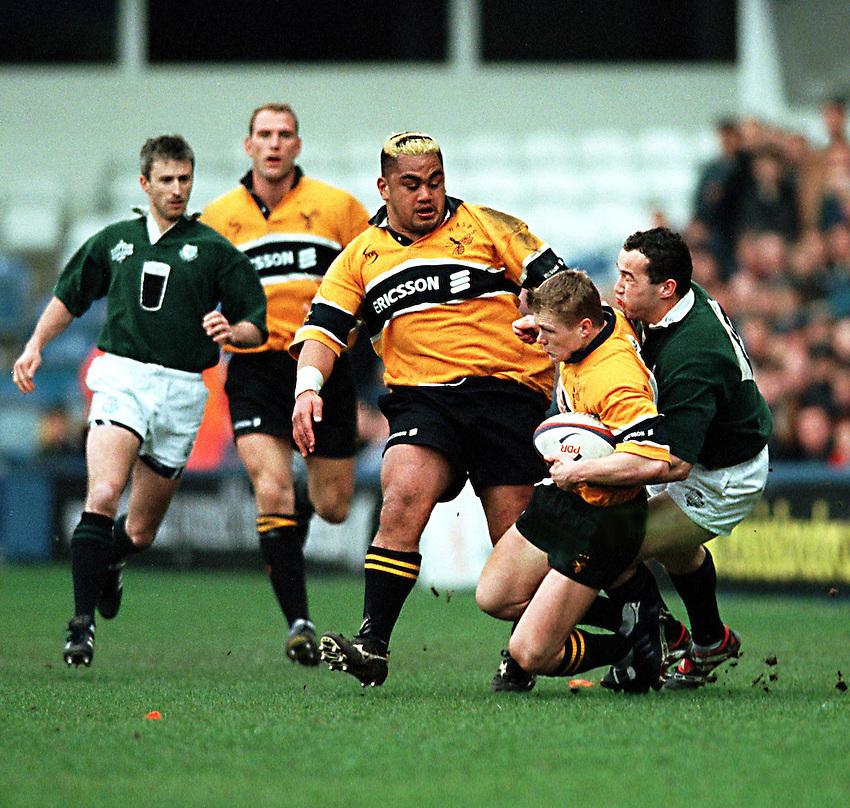 Photo. Richard Lane. .Wasps v London Irish.Tetley Bitter Cup Quarter Final.28/2/99..Josh Lewsey is caught by Conor O'Shea.