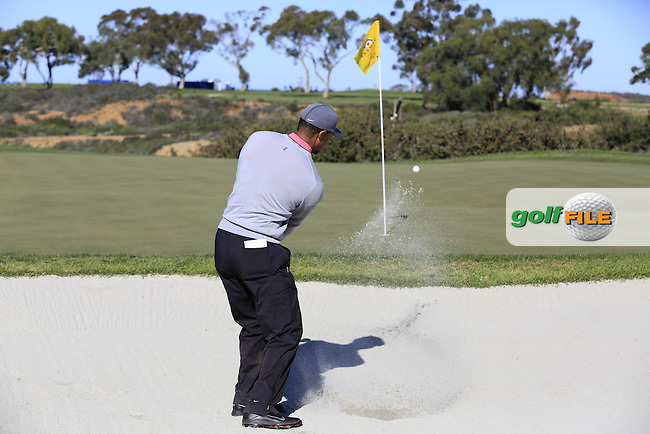 Tiger Woods (USA) chips from a bunker at the 12th green during Friday's Round 2 of the 2017 Farmers Insurance Open held at Torrey Pines Golf Course, La Jolla, San Diego, California, USA.<br /> 27th January 2017.<br /> Picture: Eoin Clarke | Golffile<br /> <br /> <br /> All photos usage must carry mandatory copyright credit (&copy; Golffile | Eoin Clarke)