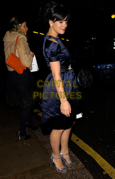 LILY ALLEN.Attends the Chanel pre Autumn / Winter Collection Show at Phillips de Pury & Co, Victoria, London, England,.December 6th, 2007..Full length navy blue dress silver ankle strap shoes star earring clutch bag black.CAP/CAN.©Can Nguyen/Capital Pictures