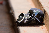 A Charlotte Knights hat rests on top of a glove in the home dugout at Knights Stadium July 20, 2010, in Fort Mill, South Carolina.  Photo by Brian Westerholt / Four Seam Images