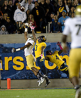 Kameron Jackson of California tries to steal the ball away from UCLA during the game at Memorial Stadium in Berkeley, California on October 6th, 2012.  California defeated UCLA, 43-17.