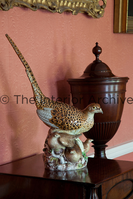 Detail of a ceramic pheasant with her brood in the dining room