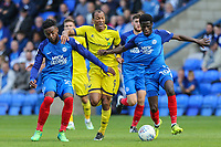 Wes Thomas of Oxford United (centre) looks for a way past Jermaine Anderson of Peterborough United (left) and Leo Da Silva Lopes of Peterborough United (right) during the Sky Bet League 1 match between Peterborough and Oxford United at the ABAX Stadium, London Road, Peterborough, England on 30 September 2017. Photo by David Horn.