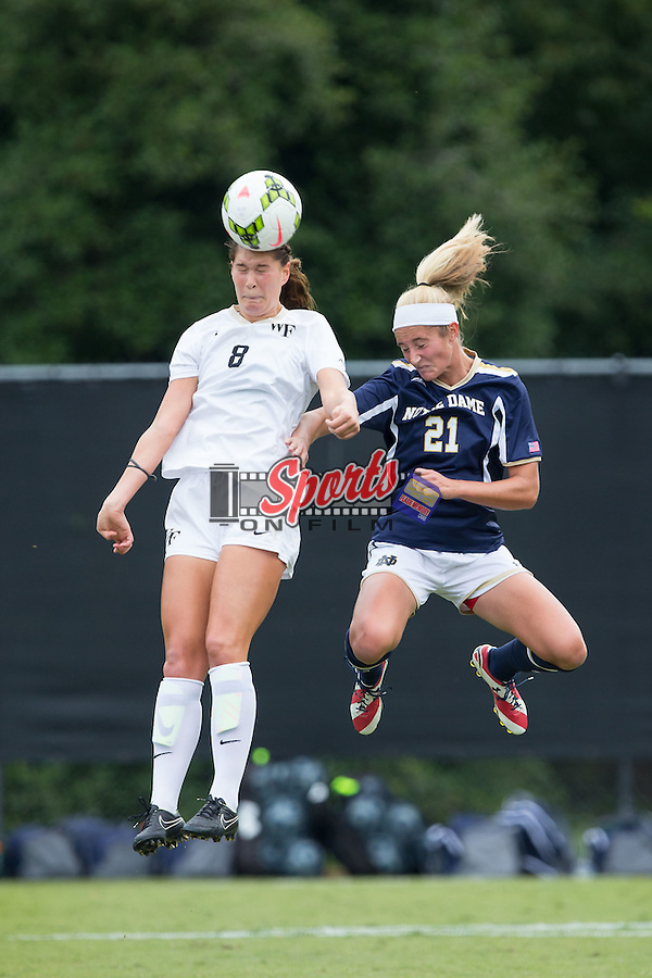 Pilar Torres (8) of the Wake Forest Demon Deacons heads the ball away from Brittany Von Rueden (21) of the Notre Dame Fighting Irish at Spry Soccer Stadium on September 28, 2014 in Winston-Salem, North Carolina.  The Fighting Irish defeated the Demon Deacons 1-0.   (Brian Westerholt/Sports On Film)