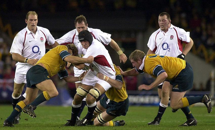 Photo. Steve Holland .Australia v England Rugby Test Match in Melbourne, Australia. 21-06-2003.Ben Kay is tackled.