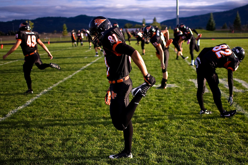 Post Falls Trojans (position) (name) (action) during a local 5A game against the East Valley Knights in Post Falls, ID on Friday night. ..Post Falls Trojans player (xxxxxx) gets ready for a local 5A football game against the East Valley Knights on Friday night in Post Falls, ID. ..Post Falls High School fans cheer on the Trojans during a game against East Valley High School on Friday night in Post Falls, ID.  ..(Matt Mills McKnight for The Spokesman-Review).