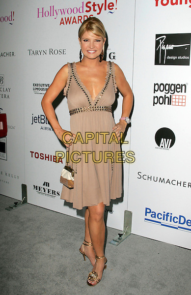 DAYNA DEVON.Hollywood Life's 2nd Annual Style Awards held at The Pacific Design Center in Beverly Hills, California  .October 2nd, 2005.full length hands on hips beige dress.www.capitalpictures.com.sales@capitalpictures.com.Supplied By Capital PIctures