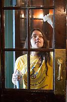 Alyssa Mallon,'20, washes windows at the Seamen's Church Institute in Newport as part of Salve Regina's Exploration Day of Service.