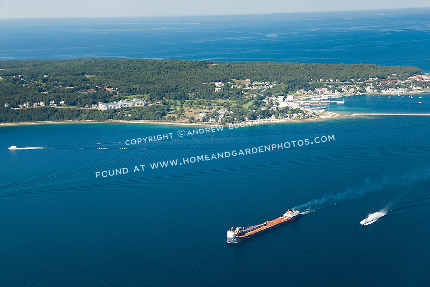 freighter and passenger ferry in Lake Huron just outside Mackinac Island, Michigan