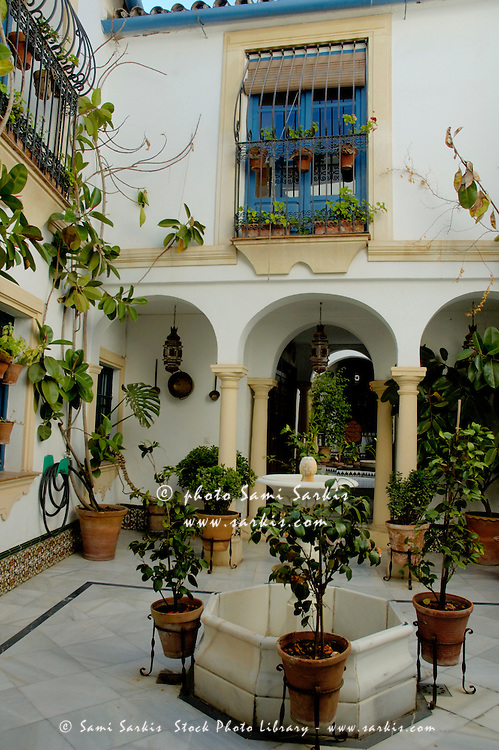 View of a courtyard in a hotel, Cordoba, Andalusia, Spain.