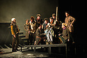 """London, UK. 02.03.2016. English Touring Opera presents """"Iphigenie en Tauride"""", by Christoph Willibald Gluck, directed by James Conway, with lighting design by Guy Hoare, at the Hackney Empire. Picture shows: Craig Smith (Thoas) and the company. Photograph © Jane Hobson."""