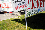 A ticket scalper sits along Washington Road selling and buying passes into The Masters golf tournament on its first practice day in Augusta, Georgia April 15, 2010. Scalpers must stay 2,500 feet from Augusta National's property line.